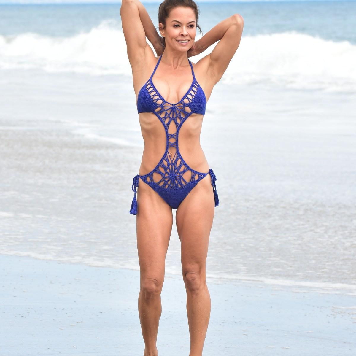 Brooke Burke, 47, Shows Off Her Bikini Body While Taking a Walk on the Beach — See How Great She Looks!