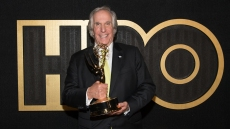 Henry Winkler holding an Emmy after winning big at the 2018 Emmys