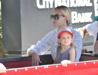 Peta Murgatroyd at farmer's market with son
