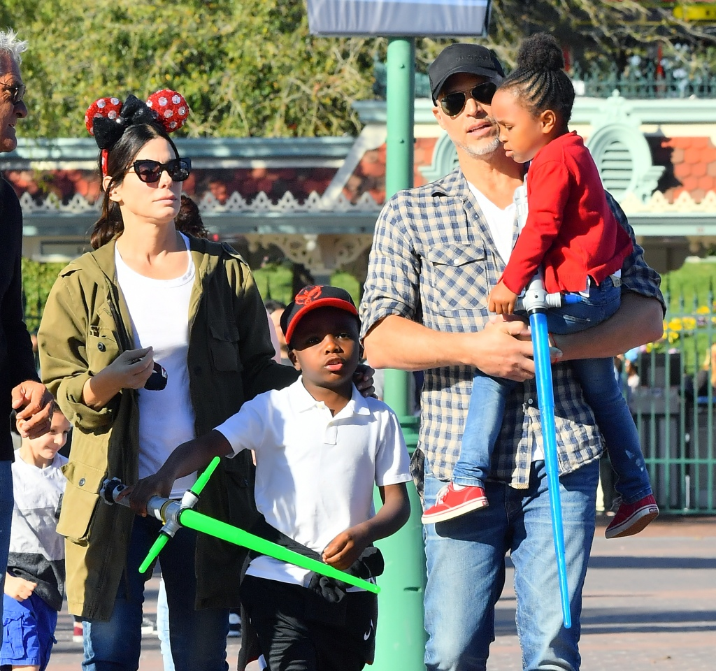 EXCLUSIVE: Sandra Bullock and her boyfriend Bryan Randall are joined by Jason Bateman and his family while spending the day at Disneyland