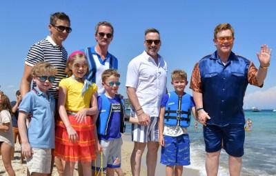 Elton John, David Furnish, Neil Patrick Harris, and David Burtka arriving at Le Club 55 in Saint Tropez