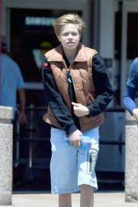 Shiloh Jolie-Pitt wears Versace shorts as she heads to best buy
