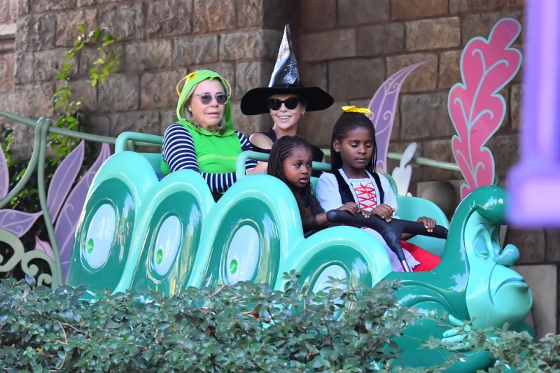 Charlize Theron gets in the Halloween spirit as she heads to Disneyland in a witch costume with her kids and mother