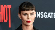 Charlize Theron Wearing a Black Blazer and a Red Lip on the Red Carpet Premiere for 'Long Shot'
