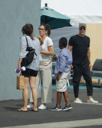 Sandra Bullock and her boyfriend Bryan Randall take their pooch to the pet store in West Hollywood!