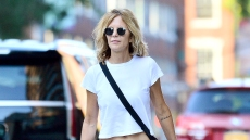 Meg-Ryan-shows-off-tattoo-and-flat-stomach
