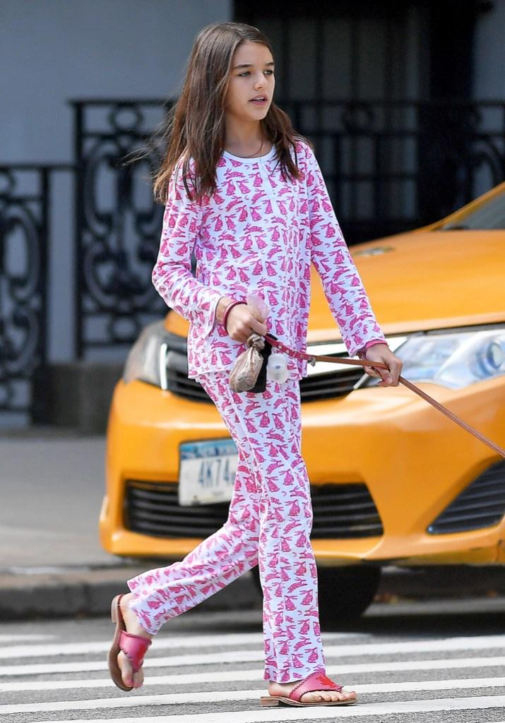 Suri Cruise rabbit printed pink outfit walking dogs New York City