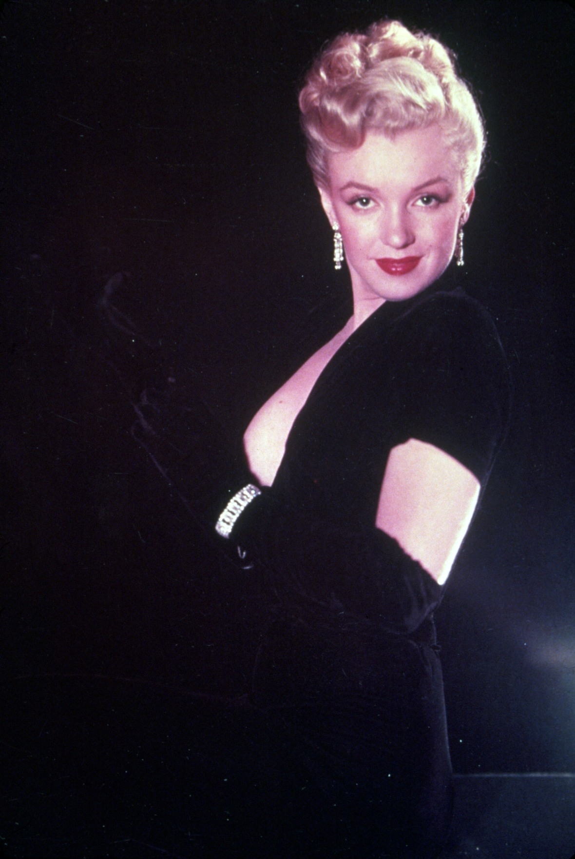 Marilyn Monroe in a Black Dress With Black Gloves