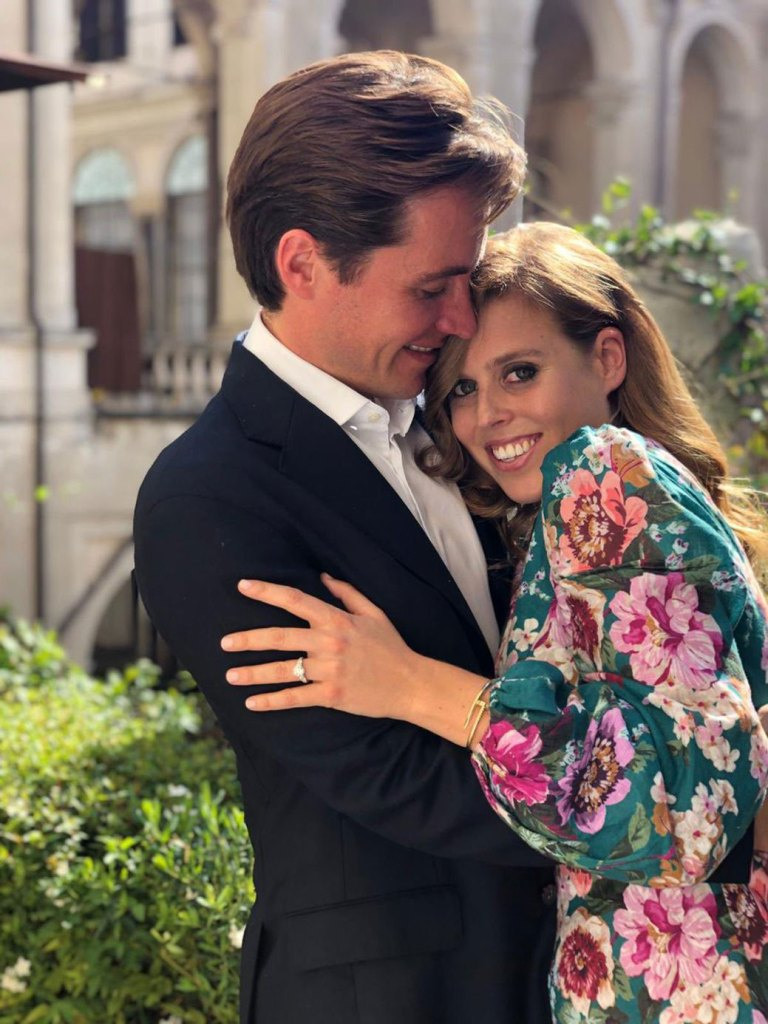 princess beatrice smiles and hugs her fiance edorado mapelli mozzi in engagement photo