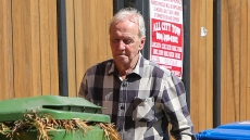 Paul Hogan is spotted wheeling out his trash bins on the morning of his 80th birthday [Tuesday October 8.]