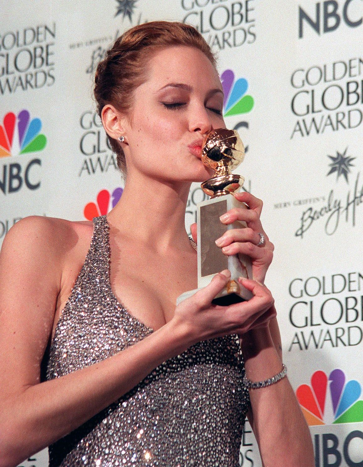 Angelina Jolie Kissing the Golden Globe Award She Won for Her Role in 'Gia'