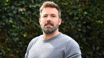 Ben Affleck Carrying an Iced Coffee While Wearing a Gray Shirt and Jeans