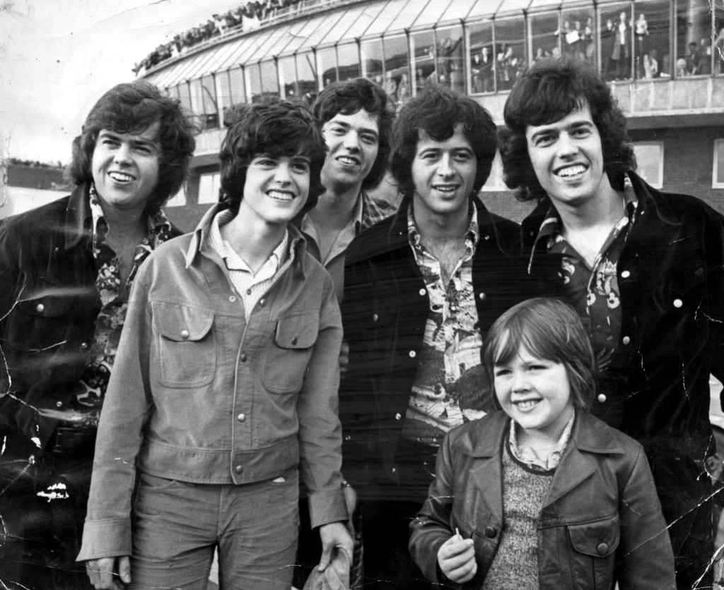 The Osmonds Pop Group Pictured At London Airport. Left To Right Are Merrill Donny Jay Wayne Alan And Jimmy.