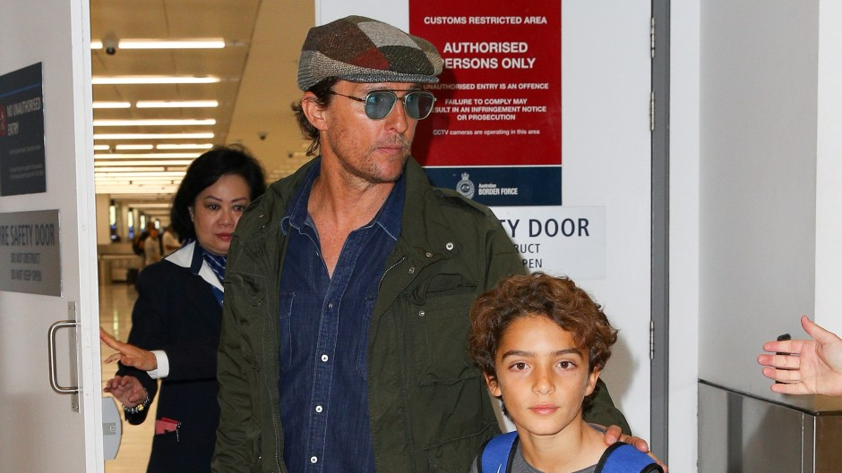 Matthew McConaughey pictured on arrival into Sydney with his son.