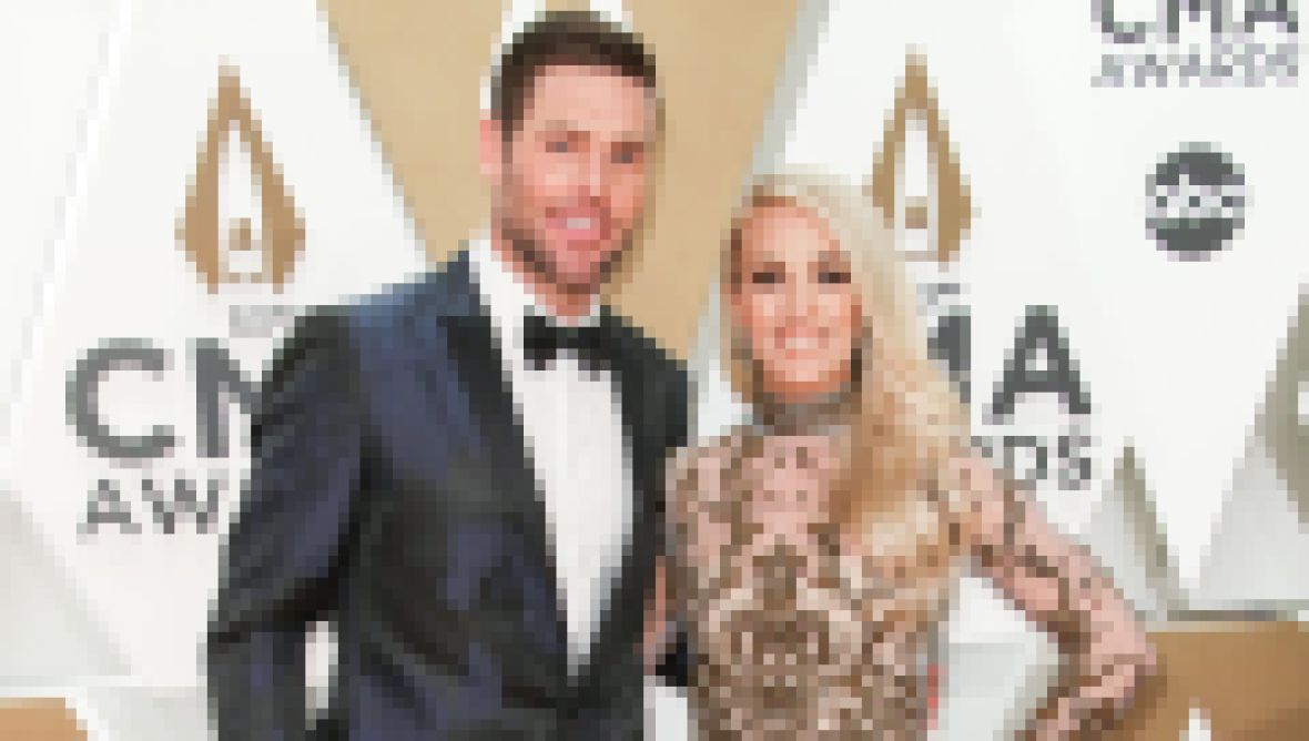 Carrie Underwood and Mike Fisher at the CMAs 2019 Red Carpet
