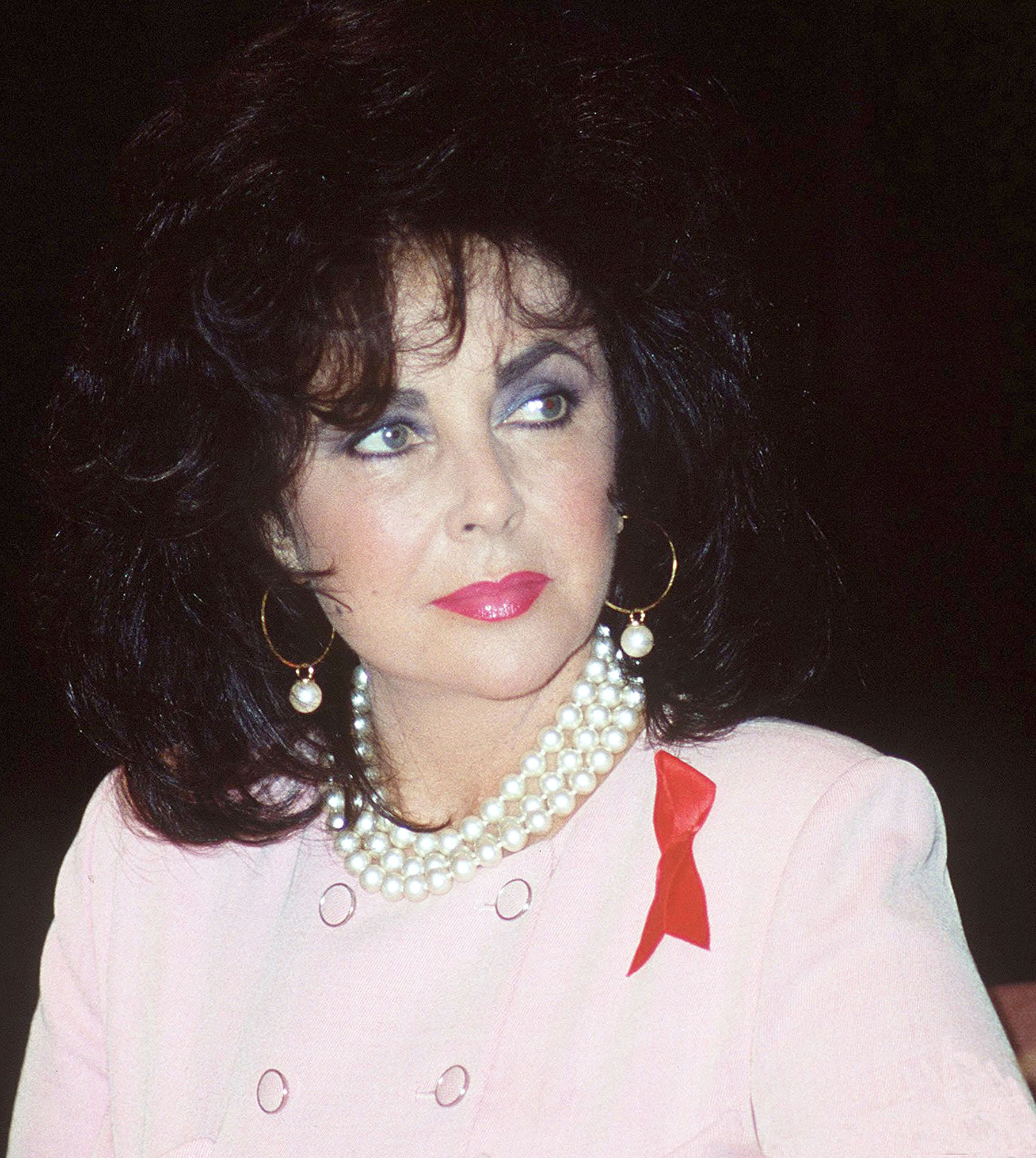 Elizabeth Taylor Wearing a Red Ribbon for Those With HIV