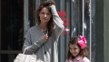 Suri Cruise wearing a Jackie Kennedy-style pink coat with Katie Holmes in New York.