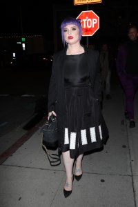 Kelly Osbourne is all smiles as and her friend grab dinner at LA hot spot Craig's