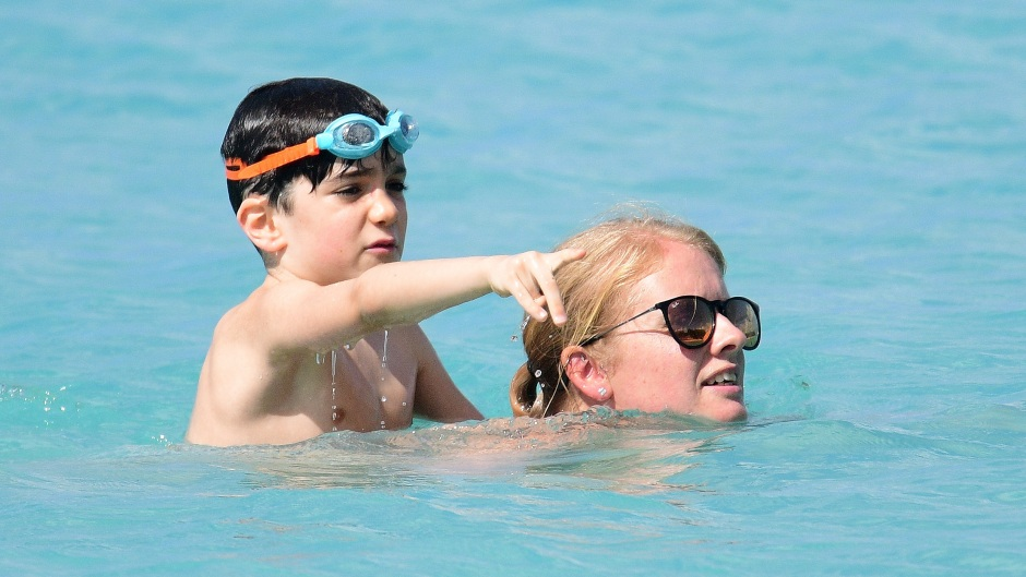 Simon Cowell's son Eric pictured with nanny on the beach in Barbados