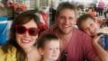 Curtis Stone Wearing a Red Shirt With His Wife and 2 Kids