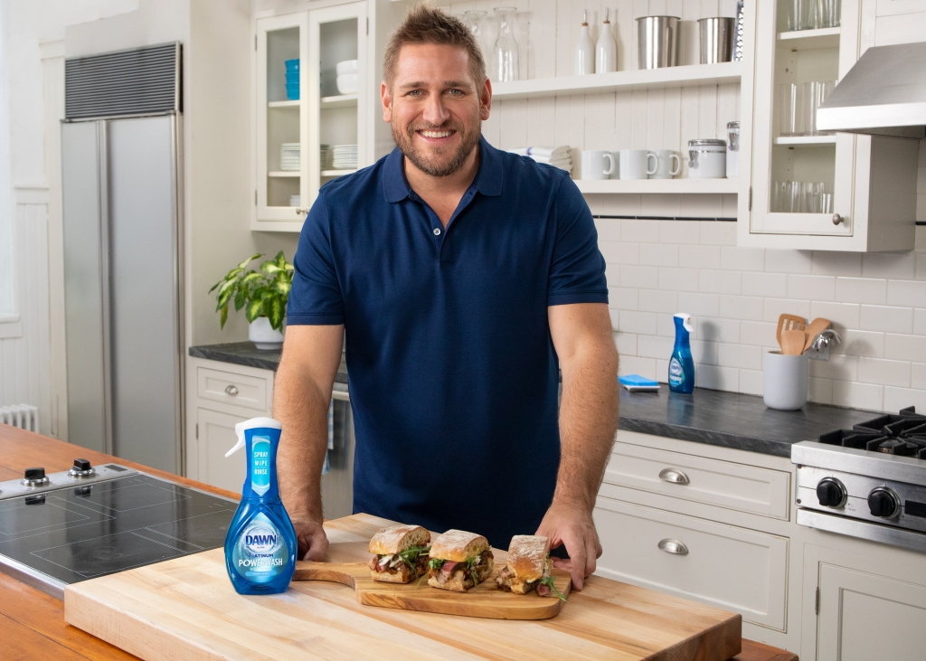 Curtis Stone Wearing a Blue Shirt With Dawn Dish Soap