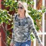 Helen Hunt wearing a camouflage hoodie and jeans seen running errands in LA