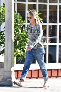 Helen Hunt wearing a camouflage hoodie and jeans seen running errands in LA