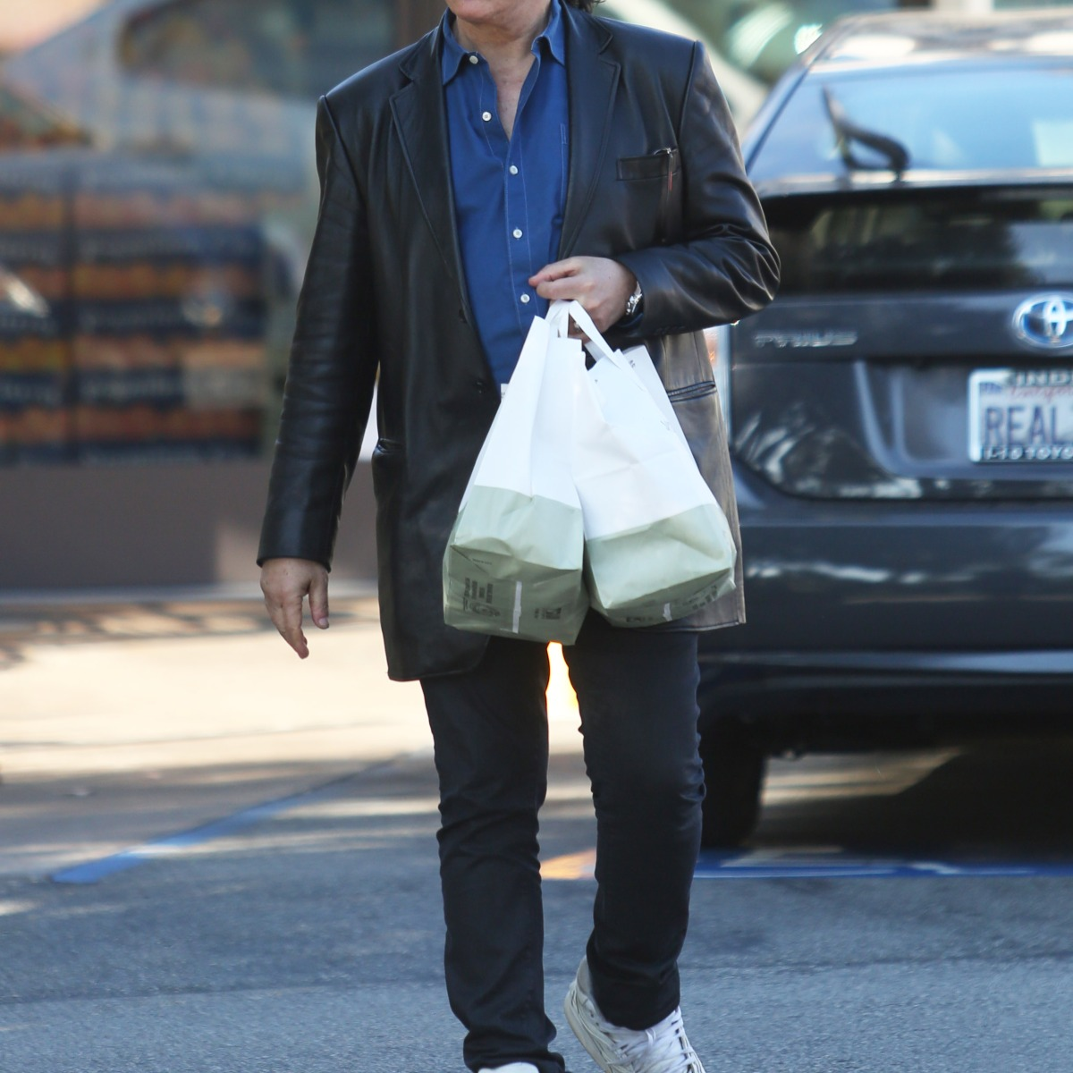 Kiss Frontman Gene Simmons Helps Wife Shannon Tweed With the Groceries After Visiting the Market