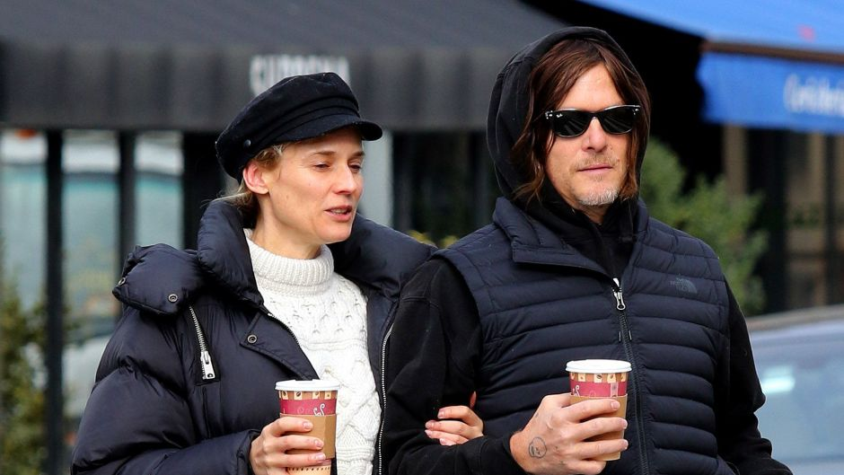 Diane Kruger and Norman Reedus walk arm-in-arm as they go for a morning coffee run in NYC