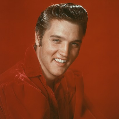 Elvis Presley Smiling in a Red Outfit