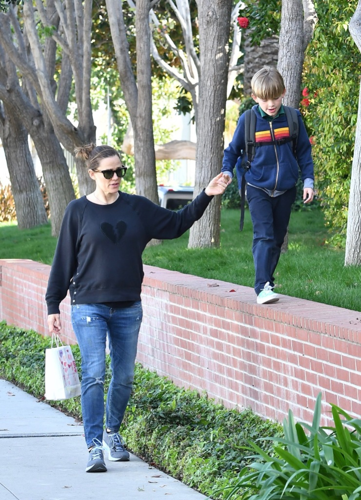 Jennifer Garner gives her son a piggyback ride after picking him up from school.