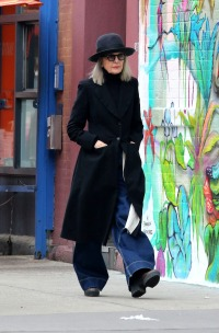 Diane Keaton is all smiles as she goes sightseeing while snapping pictures of graffiti and wall murals in NYC