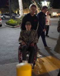 Hollywood legend James Caan looks frail as his son Jacob pushes him in a wheelchair in LA.