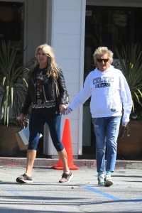Rod Stewart, 75, wears protective gloves as he steps out for breakfast with Penny Lancaster, 49, amid coronavirus COVID-19 crisis