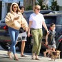 EXCLUSIVE: Simon Cowell's girlfriend Lauren Silverman takes their son Eric on dog walk with bodyguard for some fresh air