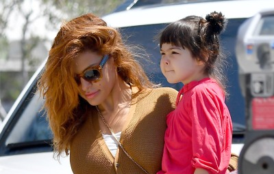 Eva Mendes has her hands full as she heads out to lunch with her two daughters