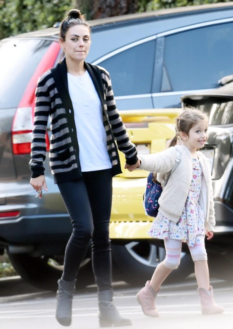 Mila Kunis and Wyatt hold hands running errands together