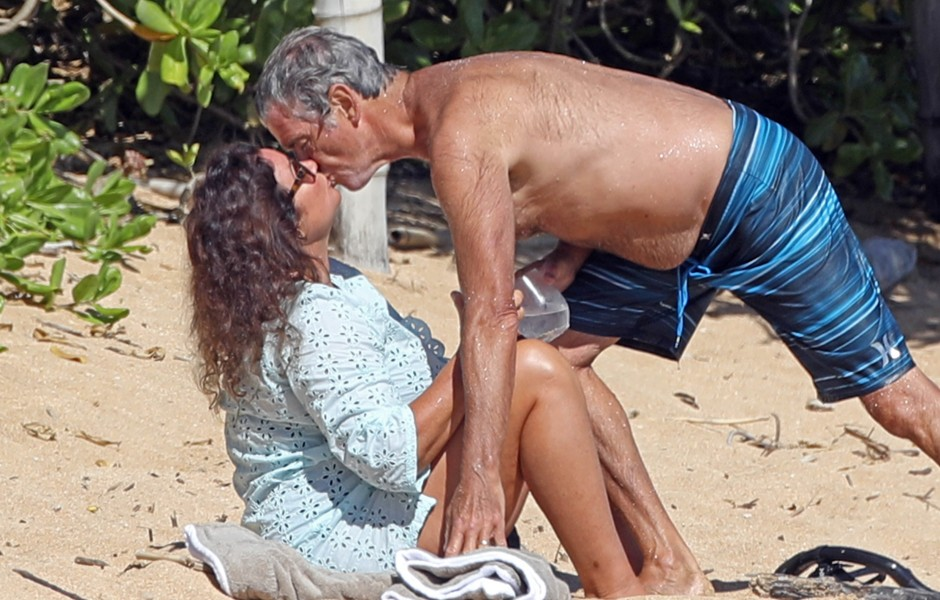 A shirtless Pierce Brosnan hits the beach and gives his wife Keely Shaye Smith a tender kiss after snorkeling while in Hawaii