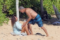 EXCLUSIVE: A shirtless Pierce Brosnan hits the beach and gives his wife Keely Shaye Smith a tender kiss after snorkeling while in Hawaii