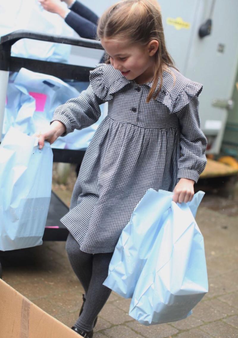 Princess Charlotte Looks Precious While Lending a Helping Hand