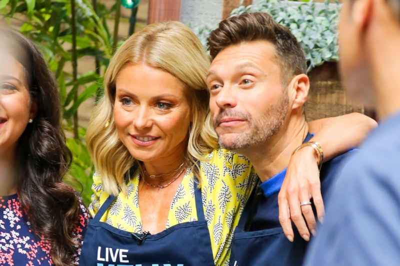 EXCLUSIVE: Ryan Seacrest and Kelly Ripa make funny faces while filming a cooking segment