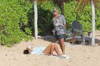 EXCLUSIVE: Pierce Brosnan relaxes on the beach with is wife Keely Shaye Smith in Hawaii