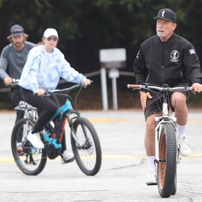 Arnold Schwarzenegger, Patrick Schwarzenegger going for a bike ride in Santa Monica