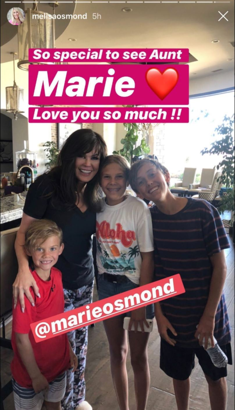 Marie Osmond and her grand nieces and nephews