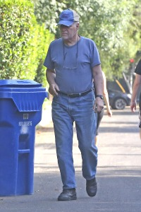 Jeopardy! host Alex Trebek spotted outside his home bringing in the trash cans,