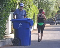 EXCLUSIVE: Jeopardy! host Alex Trebek spotted outside his home bringing in the trash cans,