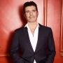 simon cowell hospitalized bike accident broken back